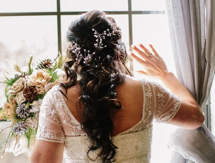 Curled hair decorated with baby's breath flowers