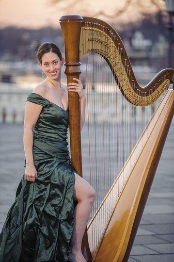 Holding the harp
