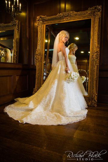 Bride in front of intricate mirror