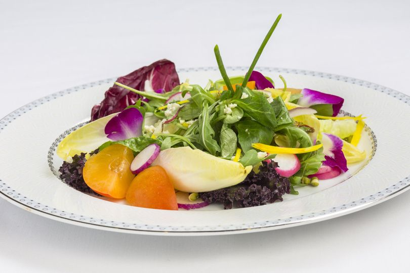 Tender greens with belgian endive, edible purple orchids, fresh apricot, shaved jewel radish, saga...