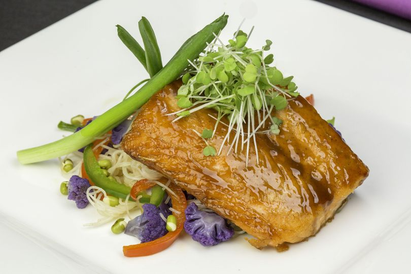 Korean barbequed salmon with rice noodles, purple cauliflower and micro greens