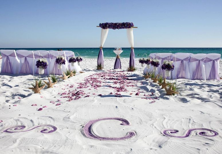 Barefoot Weddings colored monogram in the sand