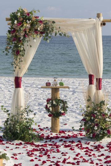 Barefoot Weddings 4 post bamboo arbor with custom florals