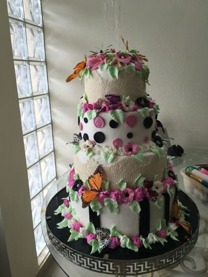 quinceanero cake with sugarpaste flowers and butterflys