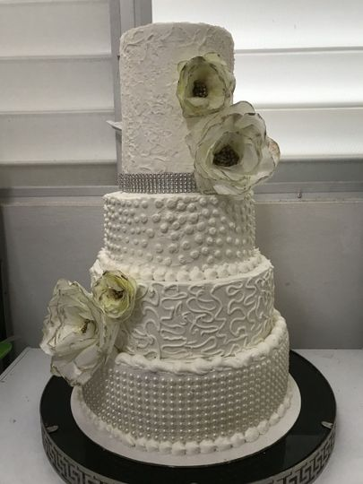 wedding cake  buttercream with waffer floers