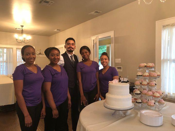 Crew posing with wedding party
