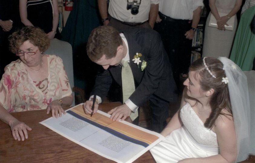 Groom signing document