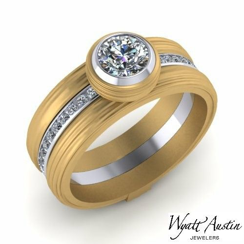 Created as matching engagement/commitment rings. The two bands are connected by the solitaire...