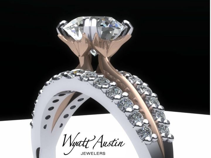 A one-of-a-kind custom engagement ring. Look closely at the prongs. You can see dolphin tails...