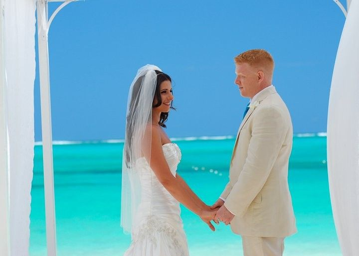 Shane & Darlene, our destination wedding clients, exchanging their vows on the beach at Beaches...
