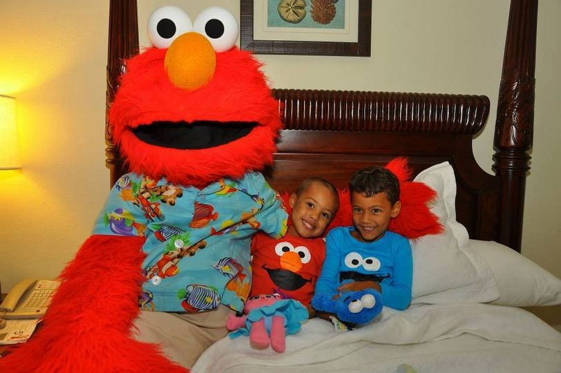 Elmo tucking in two of our adorable clients at Beaches Negril! :)