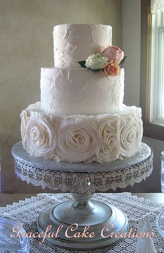 Wedding cake with white roses at the bottom