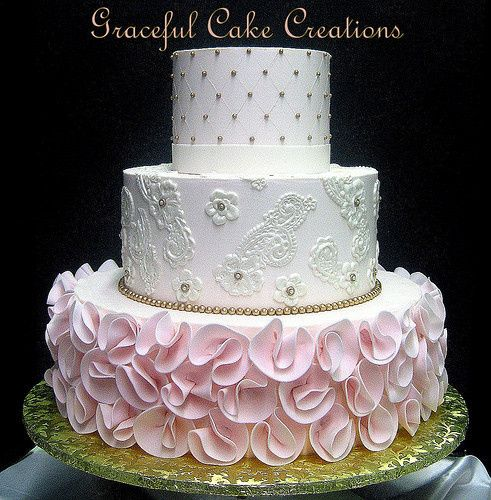 Wedding cake with pink flowers at the bottom