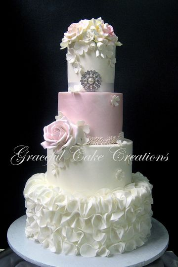 White wedding cake with a pink layer