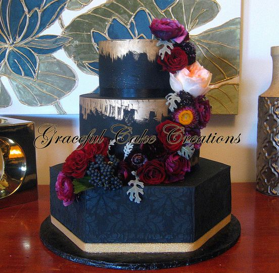Navy blue wedding cake with gold bits