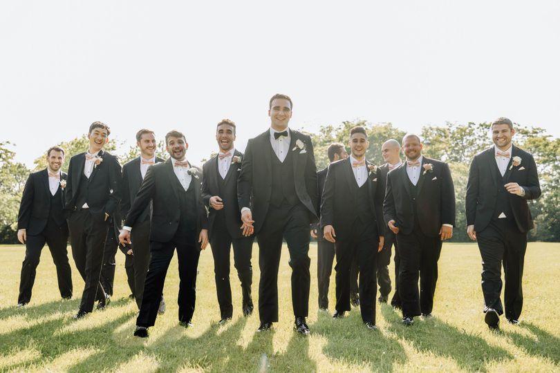 Groomsmen walk towards camera