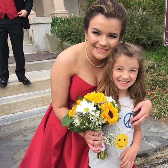 Bridesmaid with a child