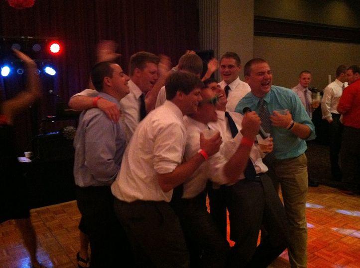 The men serenade the bride