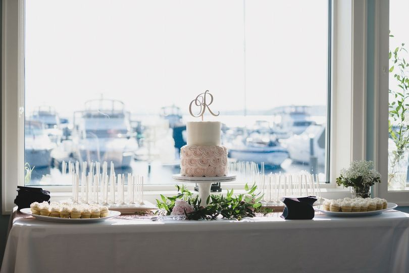 A romantic wedding cake and desserts to share
