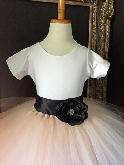 Blush skirt made from oodles and oodles of tulle.  Wide black satin ribbon sash is embellished with...