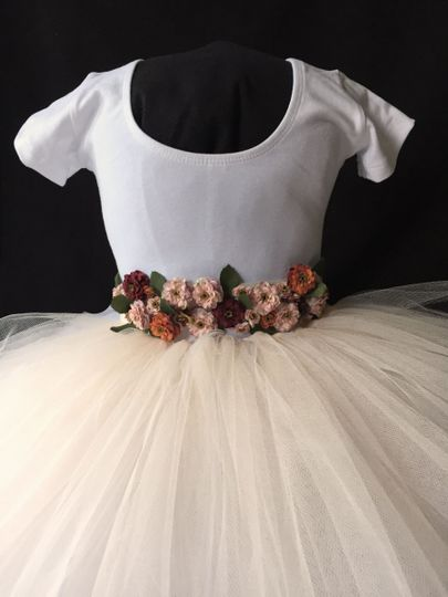 Blush skirt made with oodles and oodles of tulle. The sash is made of either a lace or ivory ribbon...