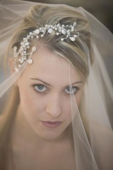 Portrait of a bride looking seductively under her veil.