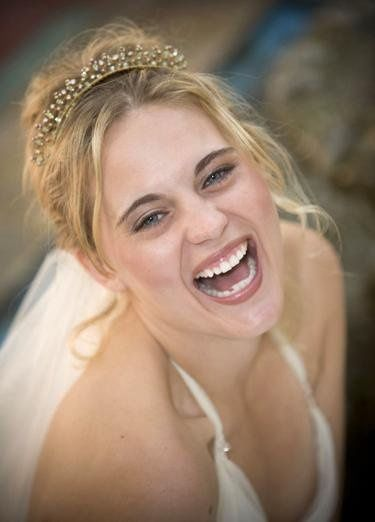 Bride bursting with laughter on her wedding day.
