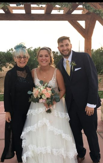 The reverend with the newlyweds
