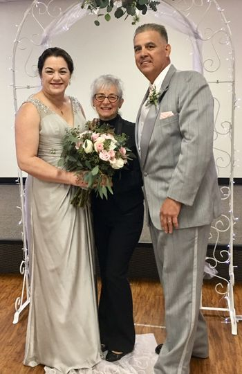 Newlyweds and their wedding officiant