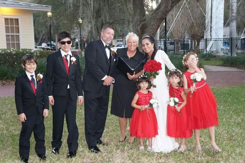 Newlyweds and their family with the officiant