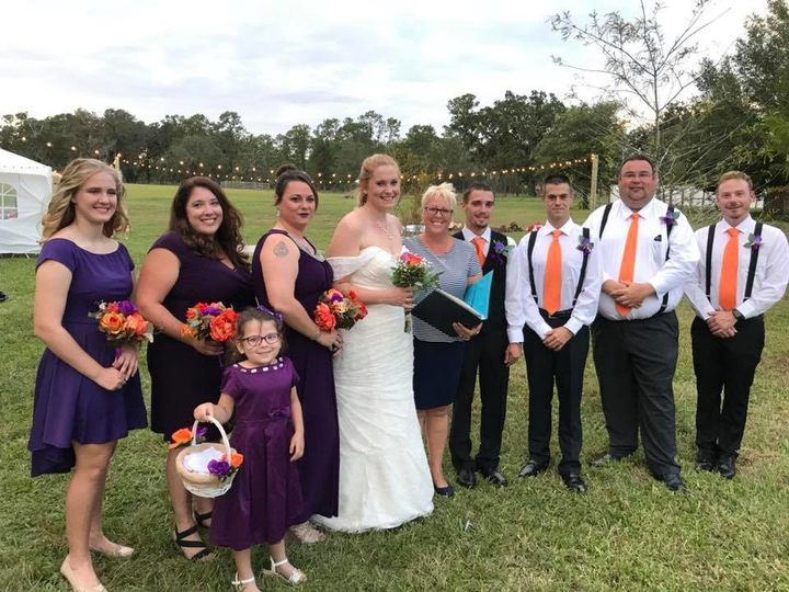 Newlyweds, guests, and officiant