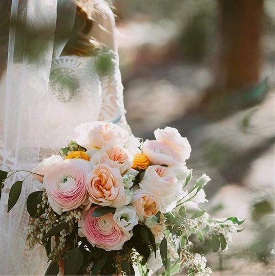 Seasonal Japanese ranunculus and garden roses