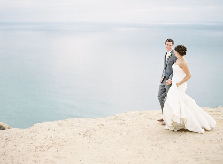 Newlyweds overlooking the sea | Photo Credit: whisker & willow photography