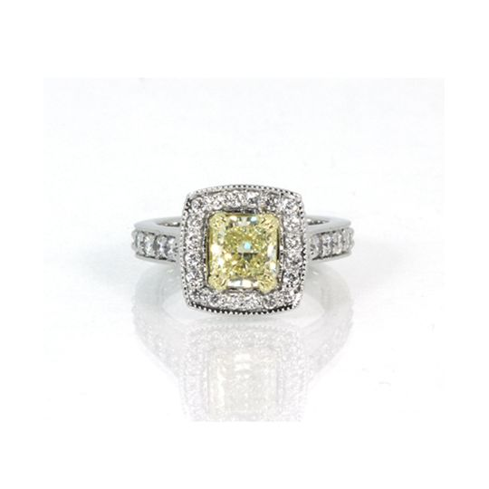 Silver ring with yellow square cut stone