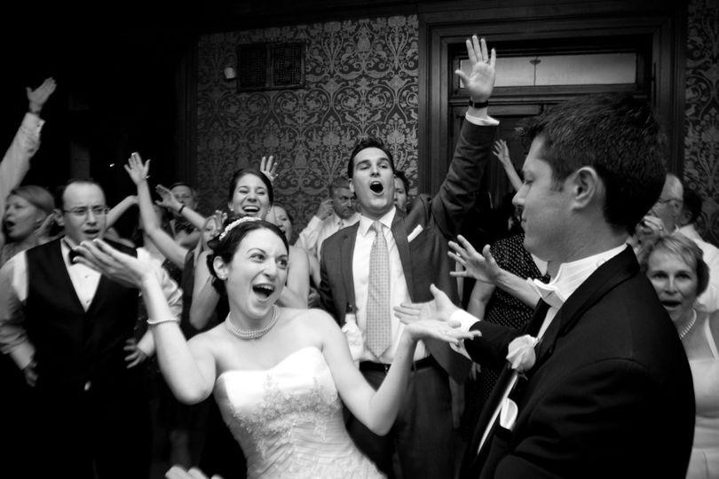 website page bride and groom dancing
