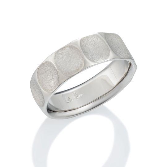 Damascus steel ring: Kona pattern with black oxide finish.