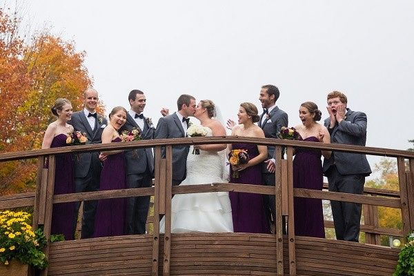 The couple with their groomsman and bridesmaids