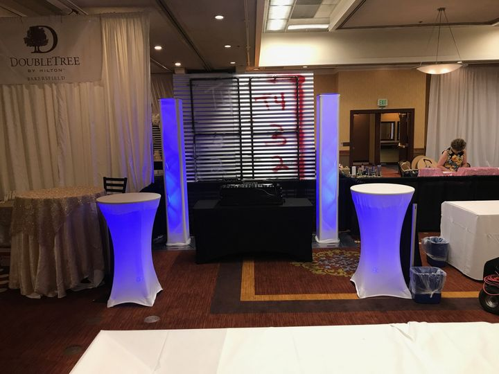 DJ booth and illuminated tables and pillars