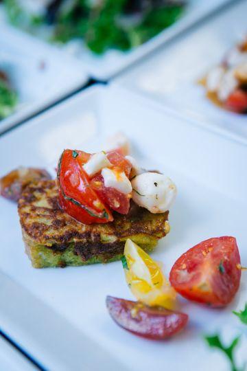 signature salad and caprese salad on herbed brioch