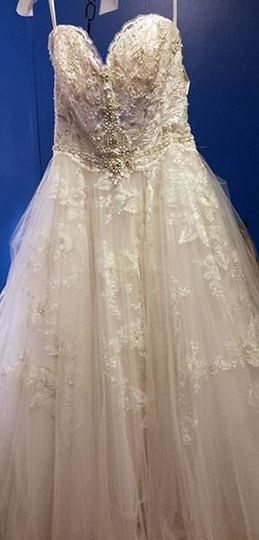 She said yes to this dress at Bridals by Lori. It was 9 layers, each had to be hemmed and bustled...