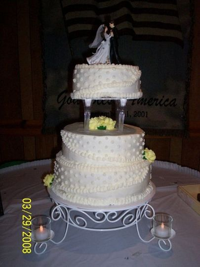 Bride requested white with yellow roses.  Cakes are from top to bottom, strawberry, chocolate fudge,...