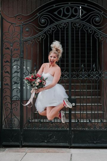 Jump shot of the bride