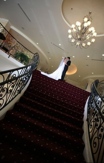 Grand stairway from hotel lobby makes a great entrance for the bride and groom
