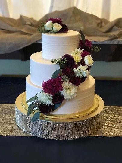 Three-layer white cake with flowers