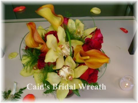 Gold Orchids are the focal point of this bouquet.