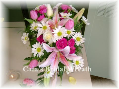 Wonmderful fragrant stargazer lilies in thisz bridal bouquet