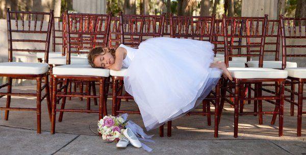 Flower girl sleeping on the chairs