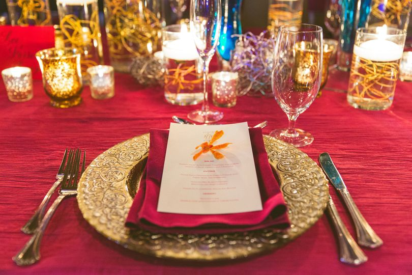 Gold cutlery and red decor