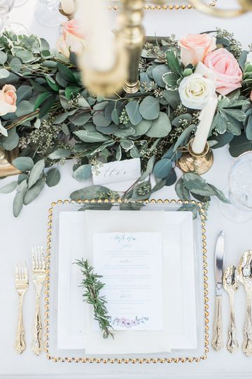 Reception table setting and decor