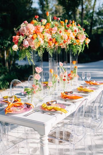 Table setting and raised floral centerpieces
